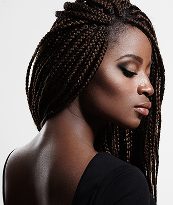 African American woman in dreadlocks with smooth skin